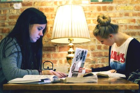 Two-women-studying-coffee-shop-laptop-notebook