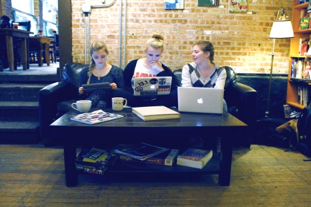 Women sitting in a coffee shop on their laptops