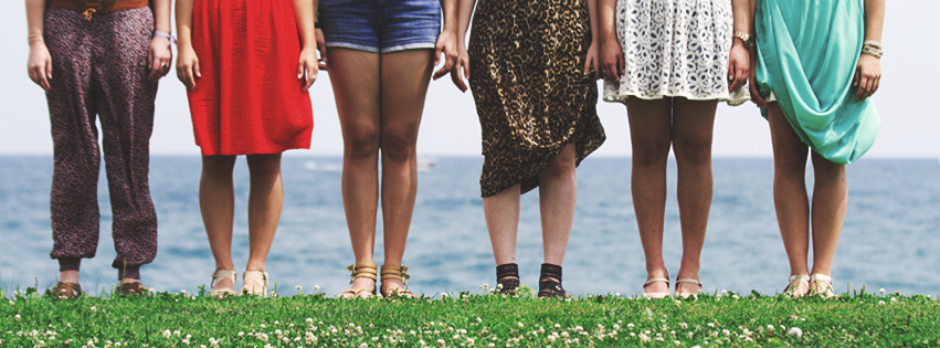 Legs of women standing near Lake Michigan in Chicago in the summer