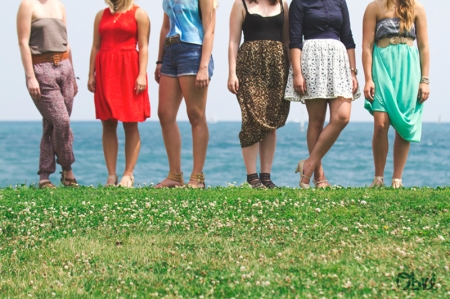 legs of women standing near Lake Michigan in Chicago in the summertime