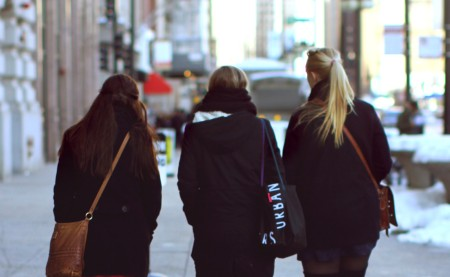 Three women walking down the sidewalk in Chicago in the winter