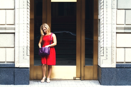 Woman In Red Dress Looking Through Her Purple Purse In Chicago