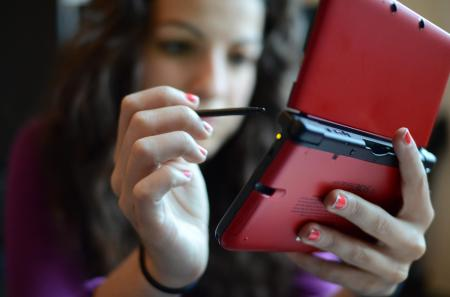 Girl Playing A Nintendo DS