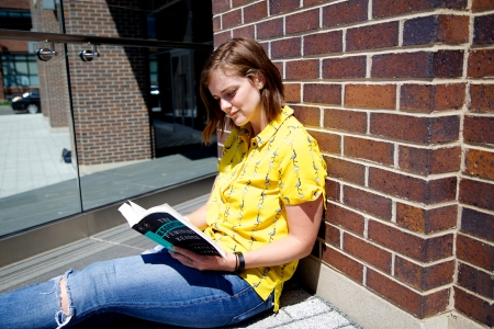 Reading-Yellow-Shirt-Sitting