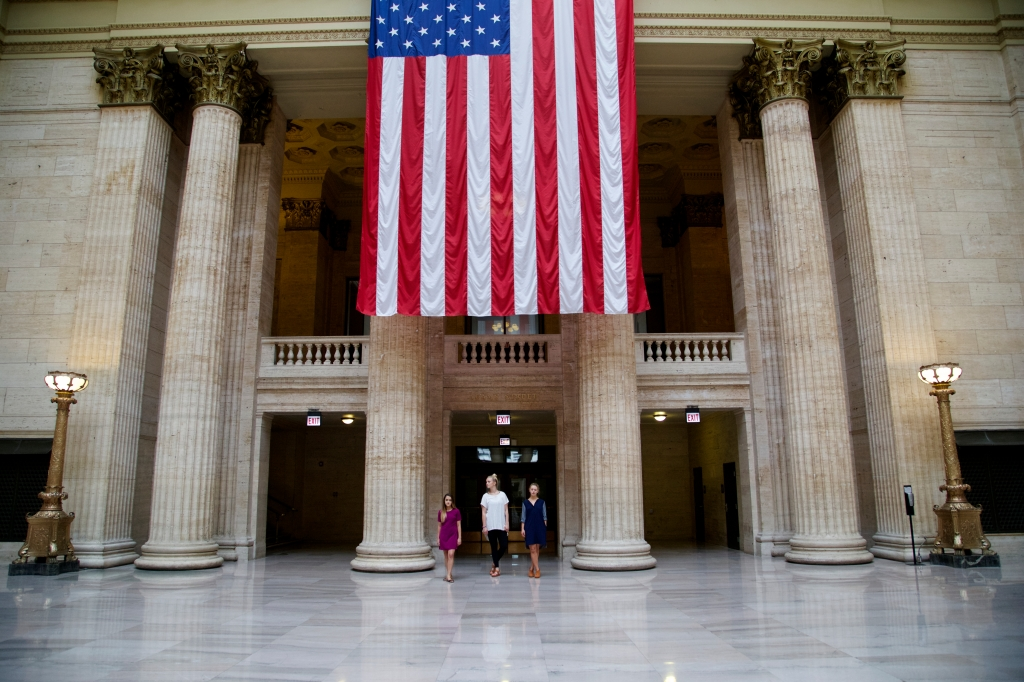Three-women-in-Union-Station-Standing-Under-an-American-Flag