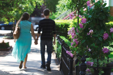 Couple-Walking-Down-Sidewalk-Summer