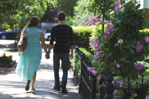 Couple-Walking-Down-Sidewalk-Summer