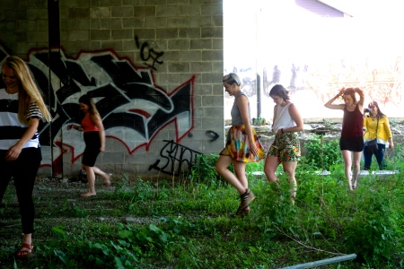 Girls-walking-abandoned-lot