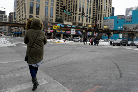 woman-walks-down-street-chicago-south-loop-winter
