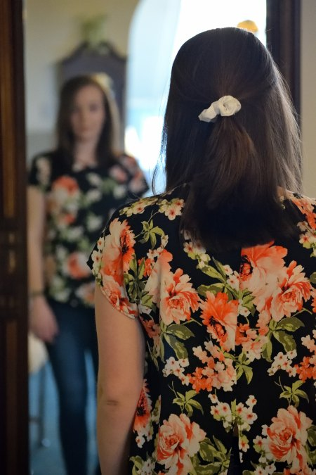 woman-looking-into-mirror-reflection